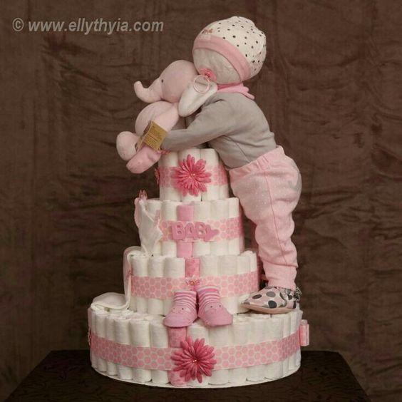 baby-girl-on-diaper-cake