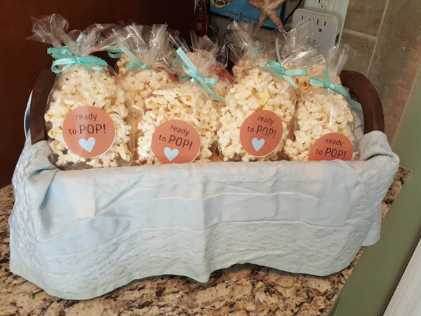 """Ready to pop"" popcorn favors in basket"