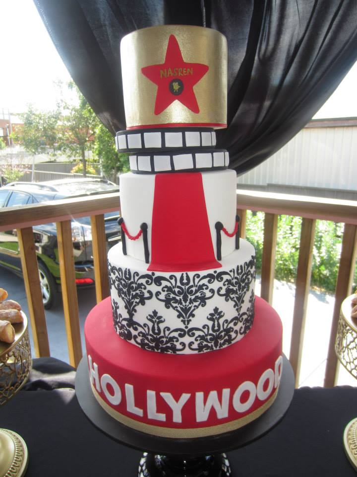 hollywood party cake with star and security poles red carpet