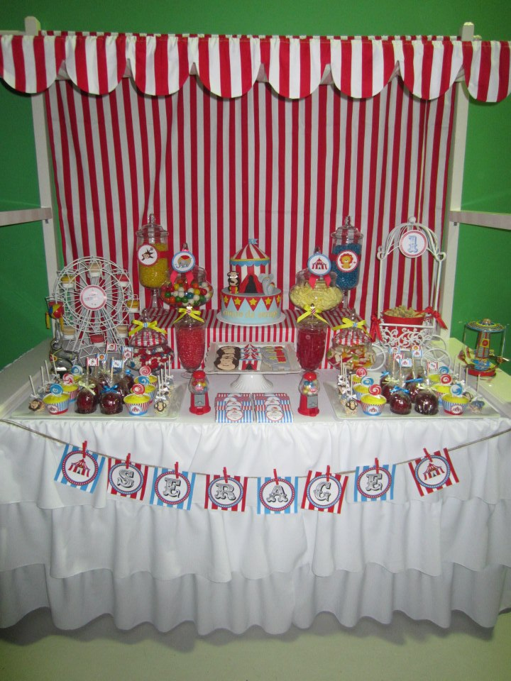 red and white stripe canopy over the dessert table