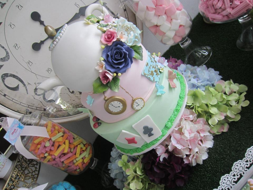 Alice in Wonderland Lopsided 3-tier cake with a tea pot on the top