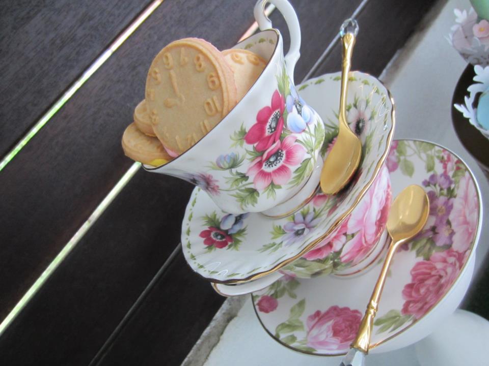 clock shaped cookies on teacups