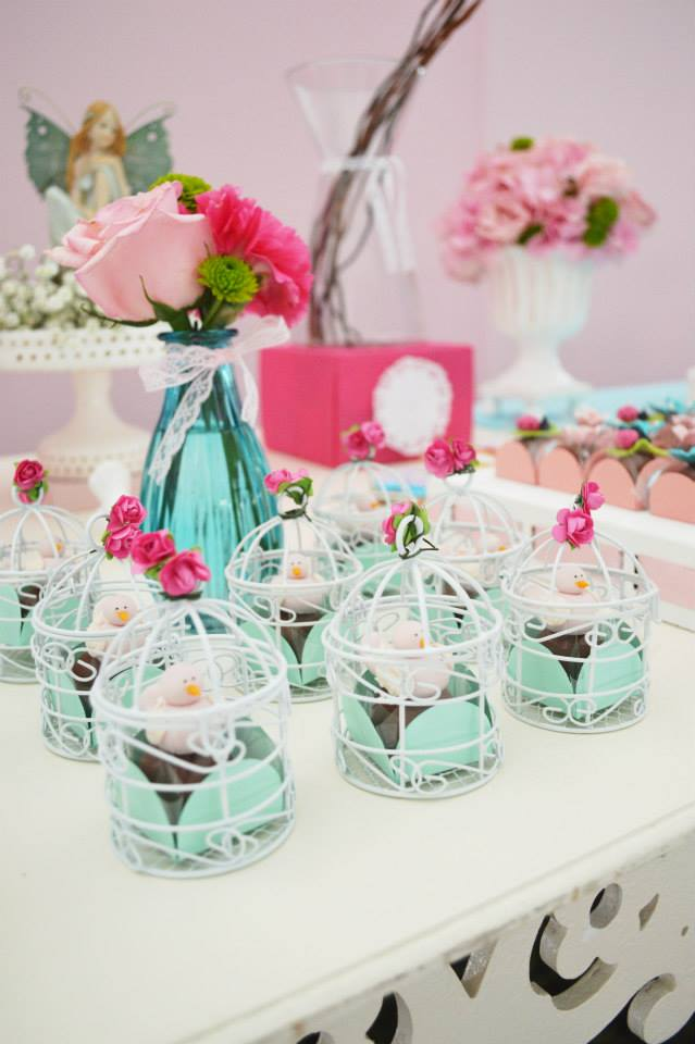 Perfect Enchanted Garden baby shower ideas via baby shower ideas and shops flowers bird cage baby shower favors