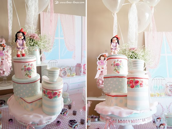 white porcelain teacup topped towel cake