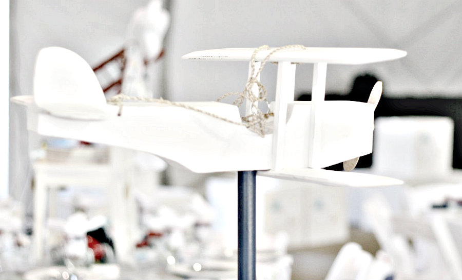 wooden aircraft centerpiece painted in white