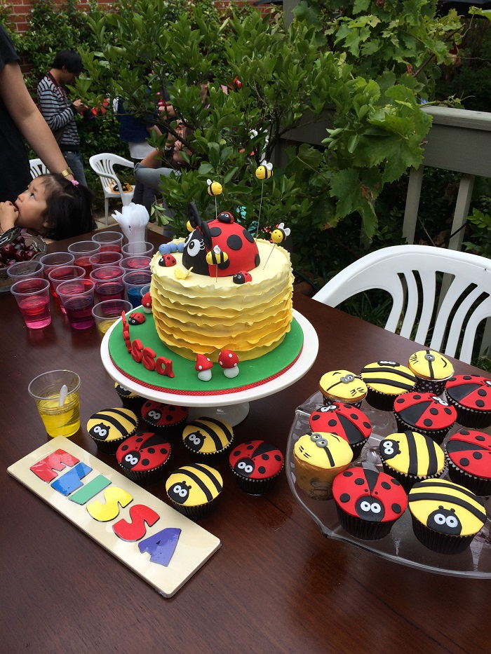 yellow ruffle cake with giant ladybug