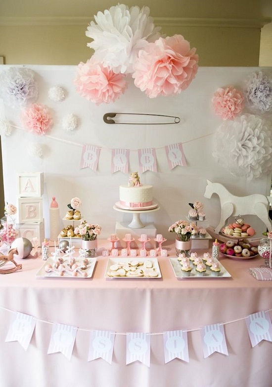 pale pink and white paper poms backdrop dessert table
