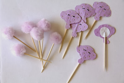 purple pom pom and elephant toppers