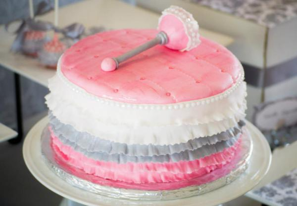 Princess like centerpiece ruffle cake with a rattle