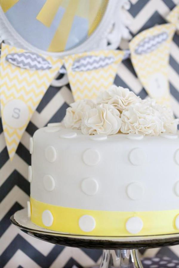 Ivory flower cake with chevron banner backdrop