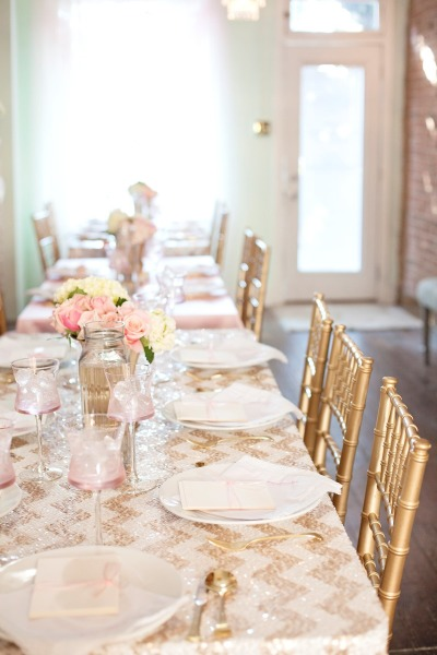 Sparkling gold and white chevron  linen table cover The historic house setting - absolutely beautiful! Gold chairs Pretty lace napkins
