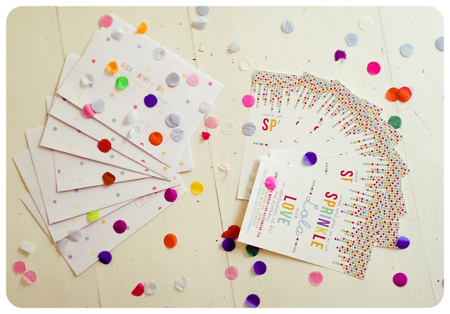 paper confetti on invitation card