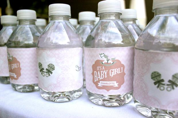 baby naming baby shower party pink and white for baby girl by keren via babyshowerideas4u.com buffet table water bottle labeled