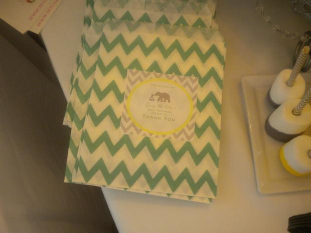 bundle of joy baby shower theme via babyshowerideas4u.com grey and yellow thank you chevron bags