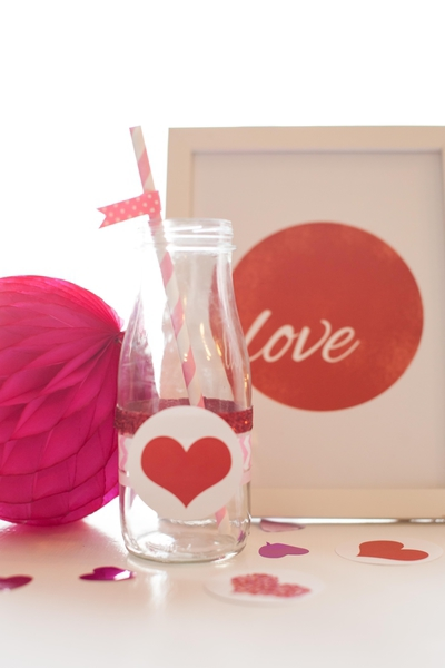 glass bottles decorated with hearts and sparkly ribbons