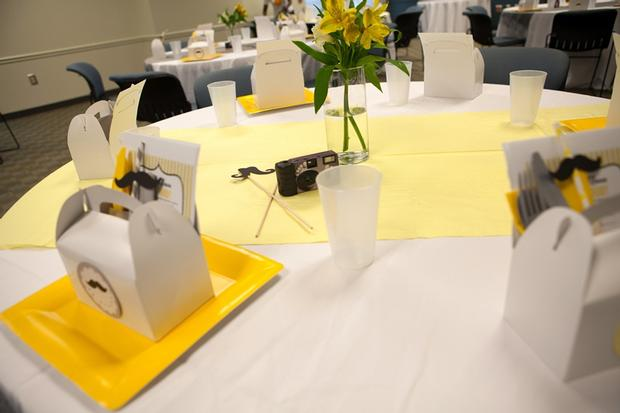 A delightful yellow and gray Little Man themed baby shower