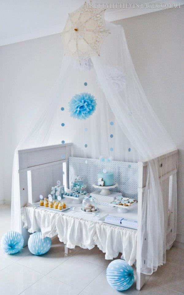 Showered from above Shower Baby Shower theme by Justine via babyshowerideas4u.com - adorable crib as dessert table!