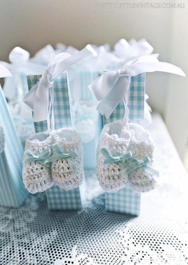 Showered from above Shower Baby Shower theme by Justine via babyshowerideas4u.com baby booties tags