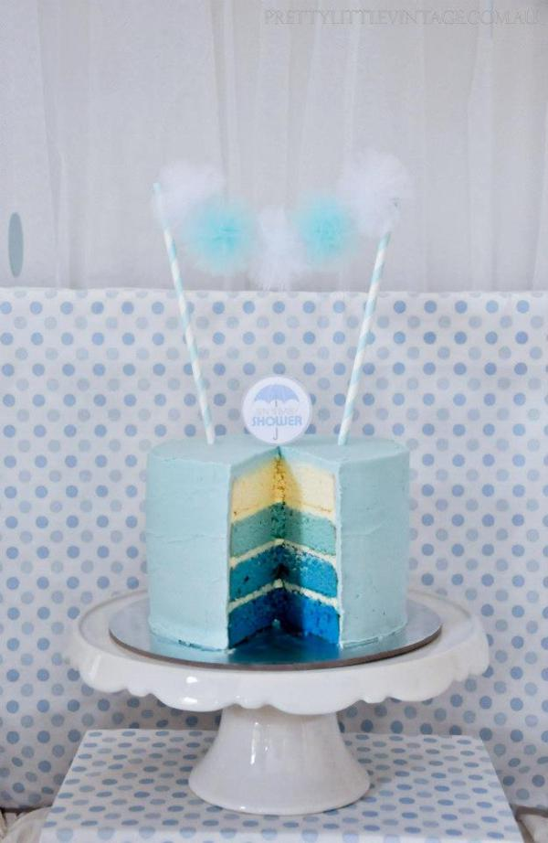 Showered from above Shower Baby Shower theme by Justine via babyshowerideas4u.com cake with mini tulle pom pom garland