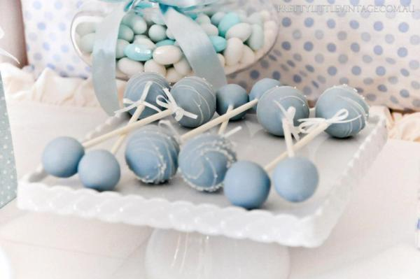Showered from above Shower Baby Shower theme by Justine via babyshowerideas4u.com - cakepops
