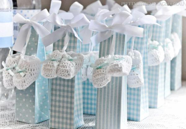 Showered from above Shower Baby Shower theme by Justine via babyshowerideas4u.com favor bags with baby booties