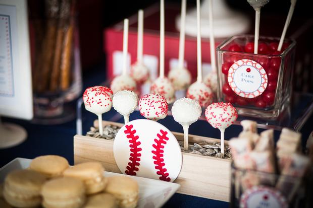 baseball baby shower ideas, blue and red colors. delicious treats, baseball cake pops, sprinkled in red and white