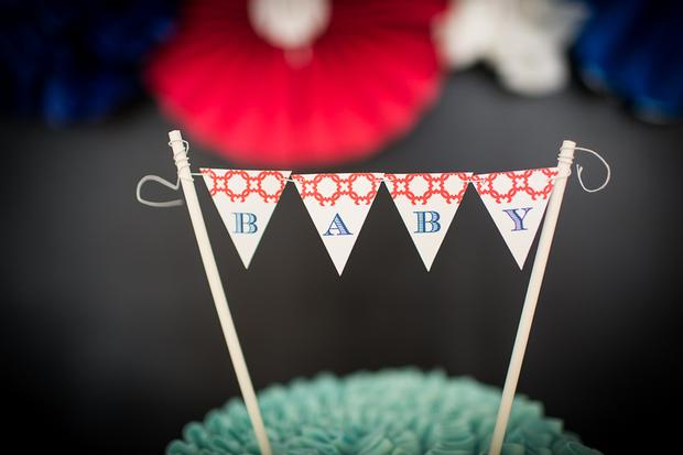 baseball themed baby shower ideas, ruffled cake with mini baseball bunting