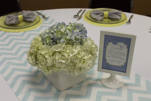 gray blue yellow baby shower ideas via babyshowerideas4u flower arrangement