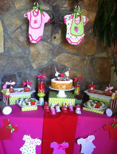strawberry themed baby shower party ideas by maria via babyshowerideas4u dessert table featuring strawberry clothes and bibs