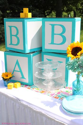 yellow and turquoise baby shower via babyshowerideas4u.com letter blocks