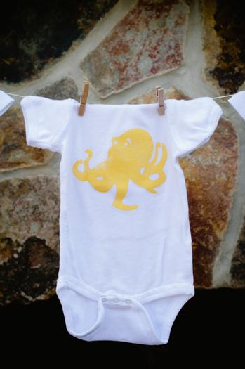 under the sea baby shower ideas, blue colored hydrangeas, baby onesies clothesline creatures