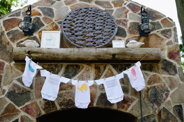 under the sea baby shower ideas, blue colored hydrangeas, baby onesies clothesline