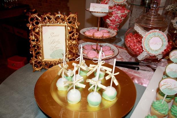 vintage glam baby shower via babyshowerideas4u, desserts, gold frames, elegant cake pops with ribbons