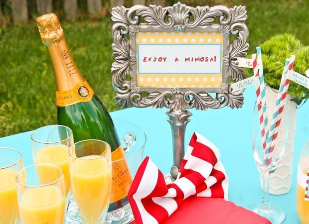 Dr. Seuss Themed Baby Shower ideas and decorations table orange juice, drink station for mimosa