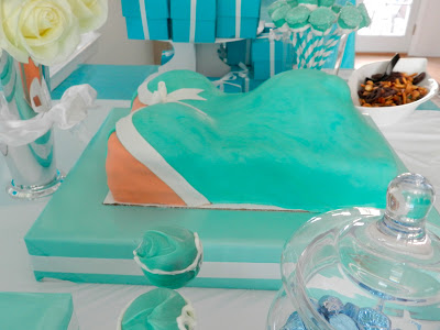 little baby blue baby shower florals pregnant belly cake