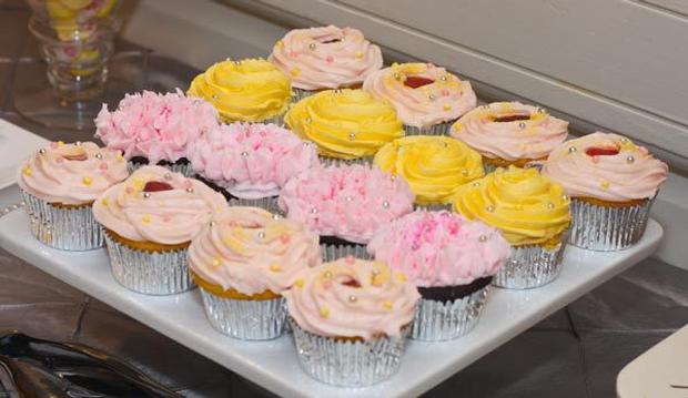 paris baby shower decorations, eiffel tower napkins, pink cupcakes, yellow cupcakes