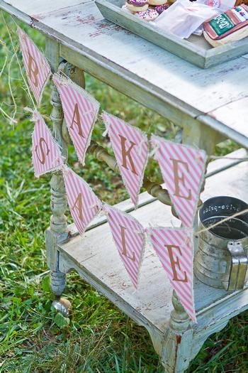 vintage bake sale styling shoot old window change to menu chalkboard vintage baking cups banner using burlap backing