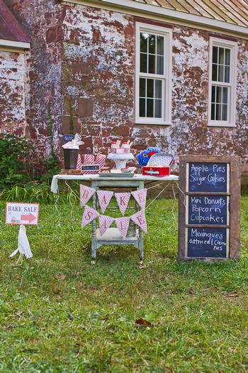 vintage bake sale styling shoot table infront of old school 1800's back to school theme party ideas