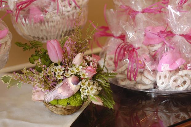 Nesting Themed Baby Shower, Bird baby shower, table setting with flower arrangement centerpiece, baby shower favors, birds