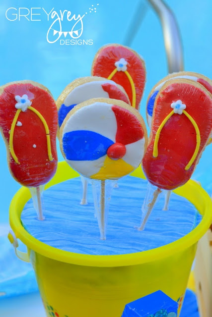 bucket of pool party theme cookies, summer pool party ideas