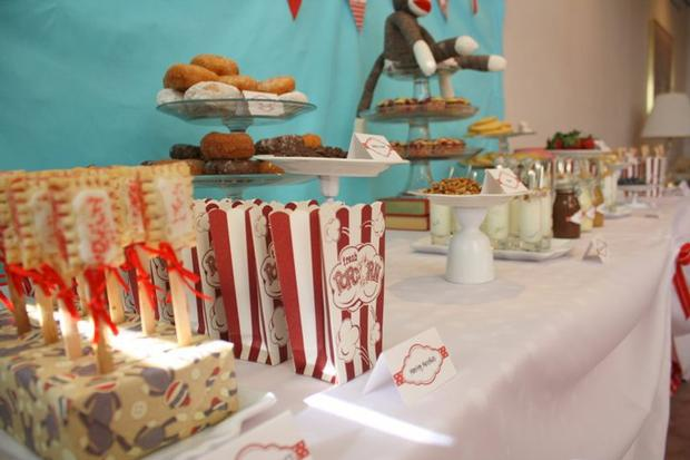 red and aqua Sock Monkey Baby Shower decorations, cake donuts, dessert table