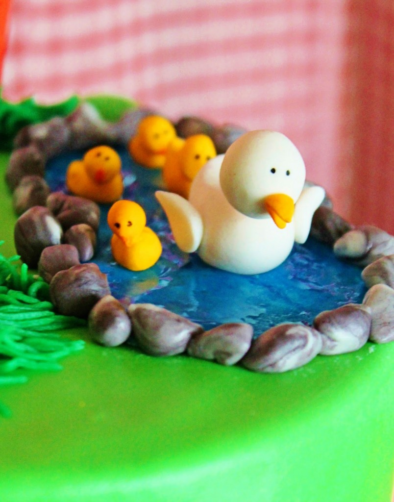 little ducks and chicks in pond cake