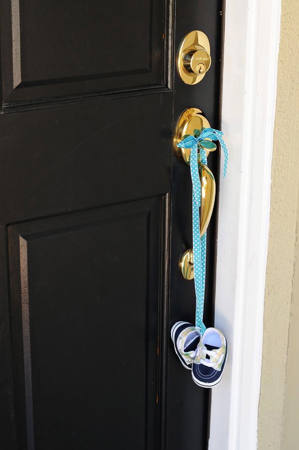 adorable baby shoes hanging on door handle