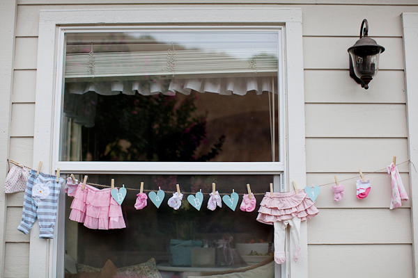aqua and pink baby clothes and sock banner