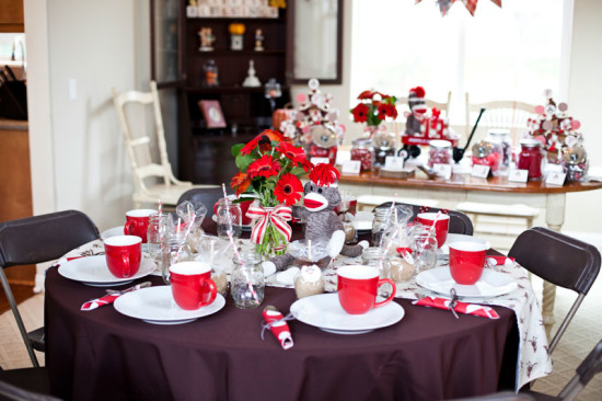 table setting in red and white with beautiful red floral centerpiece