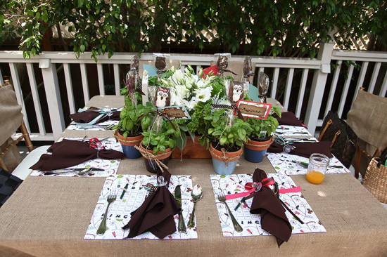 table setting with brown napkins with baby pacifiers
