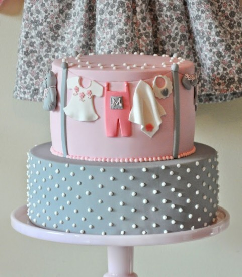 pink and grey girl onesie cake