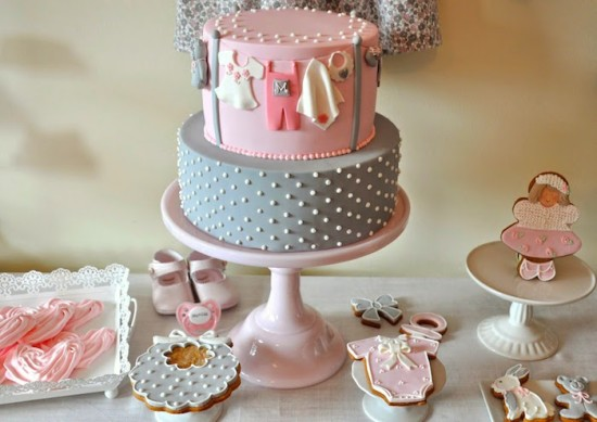 beautiful 2 tier pink and grey baby shower cake with polka dots