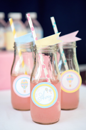 glass jars with colorful straw flags