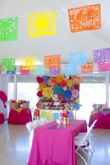 colorful Festive Mexican Baby Shower dessert table with paper flowers in backdrop